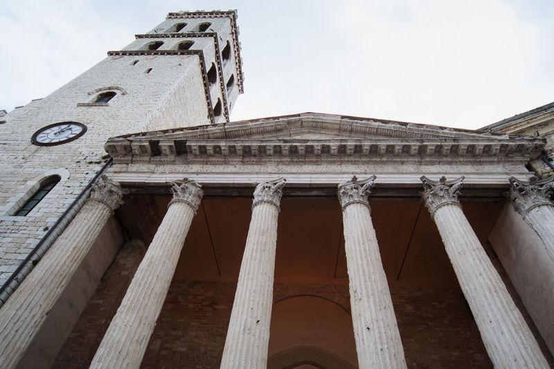 church entrance with columns and bell tower, low angle of view Ancient Ancient Civilization Architectural Column Architecture Building Exterior Built Structure Day History Low Angle View No People Outdoors Sky Travel Destinations Stories From The City