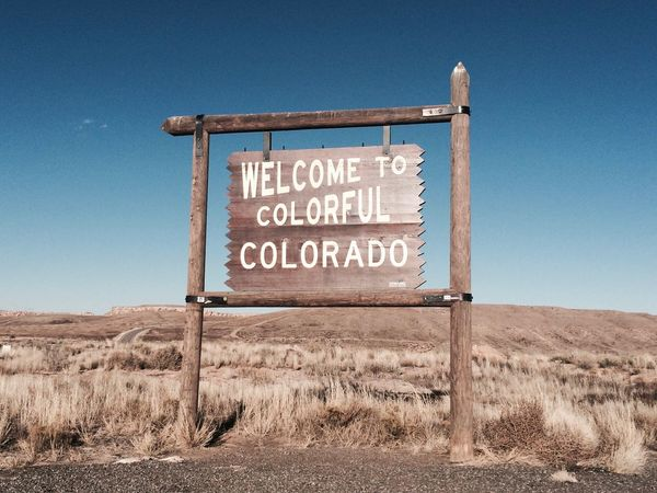 Colorado Western Script Outdoors Landscape Wild West America Desert USA Colorful Fade Welcome Sign Travel Sunny Day Hot Day Sand Colorful Colorado Text Communication Clear Sky Arid Climate No People Blue Grass Nature Sky