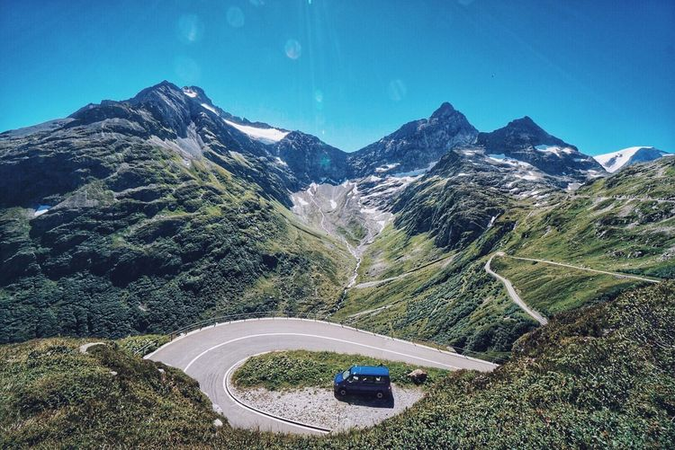 High angle view of van by road on mountain against sky