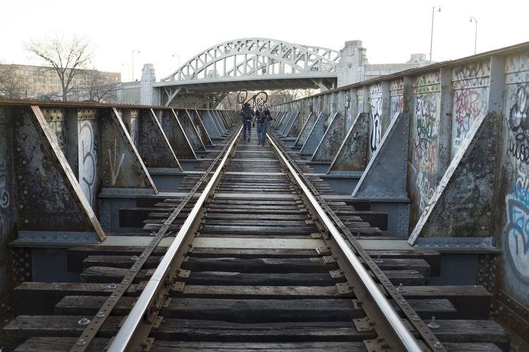 Low angle view of footbridge on bridge against sky