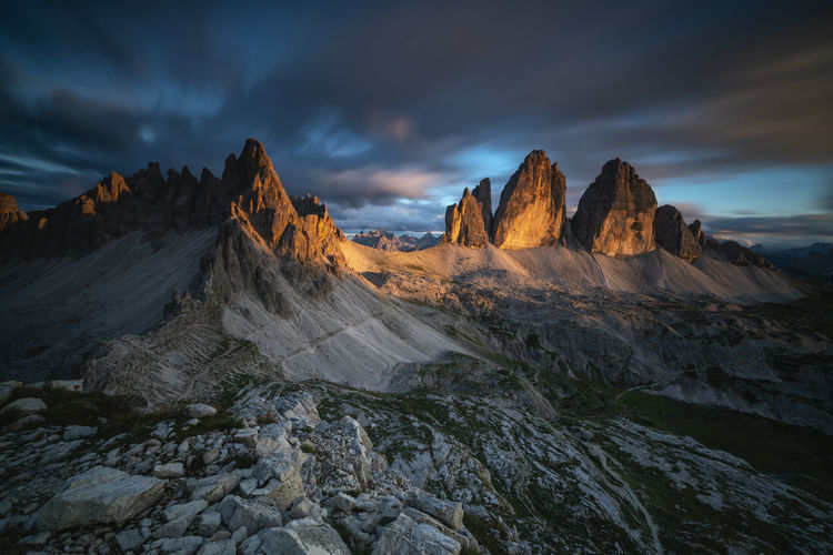 Beautiful sunset over Monte Paterno and Tre Cime di Lavaredo - Dolomites Mountains Italy. Dolomites Dolomites, Italy EyeEmNewHere Tre Cime Di Lavaredo,Drei Zinnen,Dolomiten,Misurina,Sunrise Mountain,Mountain In Clouds,forestgreen, Beauty In Nature Cloud - Sky Environment Idyllic Landscape Monte Paterno Mountain Mountain Peak Mountain Range Nature Non-urban Scene Outdoors Rock Rock - Object Scenics - Nature Sky Solid Sunset Tranquil Scene Tranquility Unesco