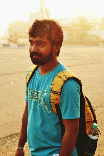 Portrait of happy man standing in city