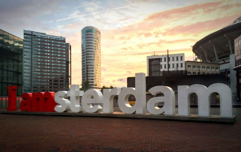 I amSTERDAM IPhoneography Iamsterdam Amsterdam Architecture Built Structure Building Exterior Sky City Office Building Exterior Building Sunset Cloud - Sky No People Text