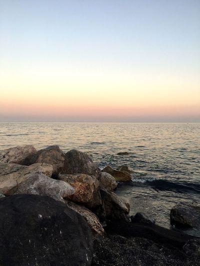 Greece Santorini Sunset Pink Sky Sea Sea And Sky Eater Beach Beachphotography Landscape Water Tranquility Seascape Iphone6s Blacksandbeach Blacksand IPhone EyeEm Nature Lover EyeEm Best Shots Eyeem Collection