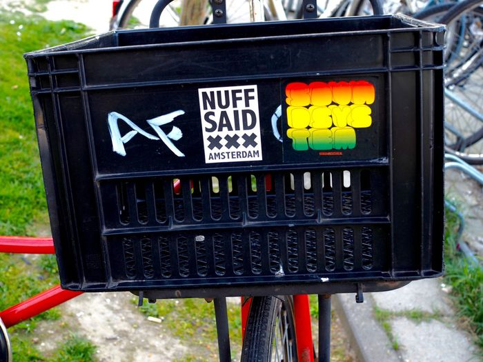 Amsterdam Bicycle Bike Close-up Communication Crate Day No People Outdoors Stickers Street Style Text Transportation