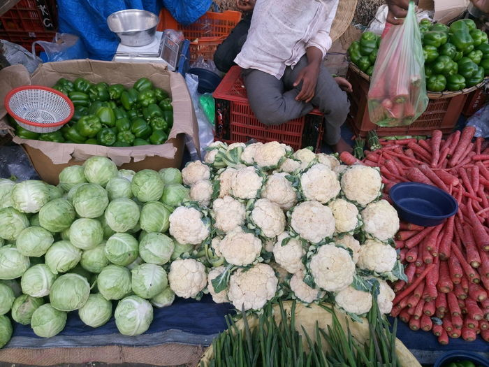 High Angle View Of Man Selling Vegetables At Market