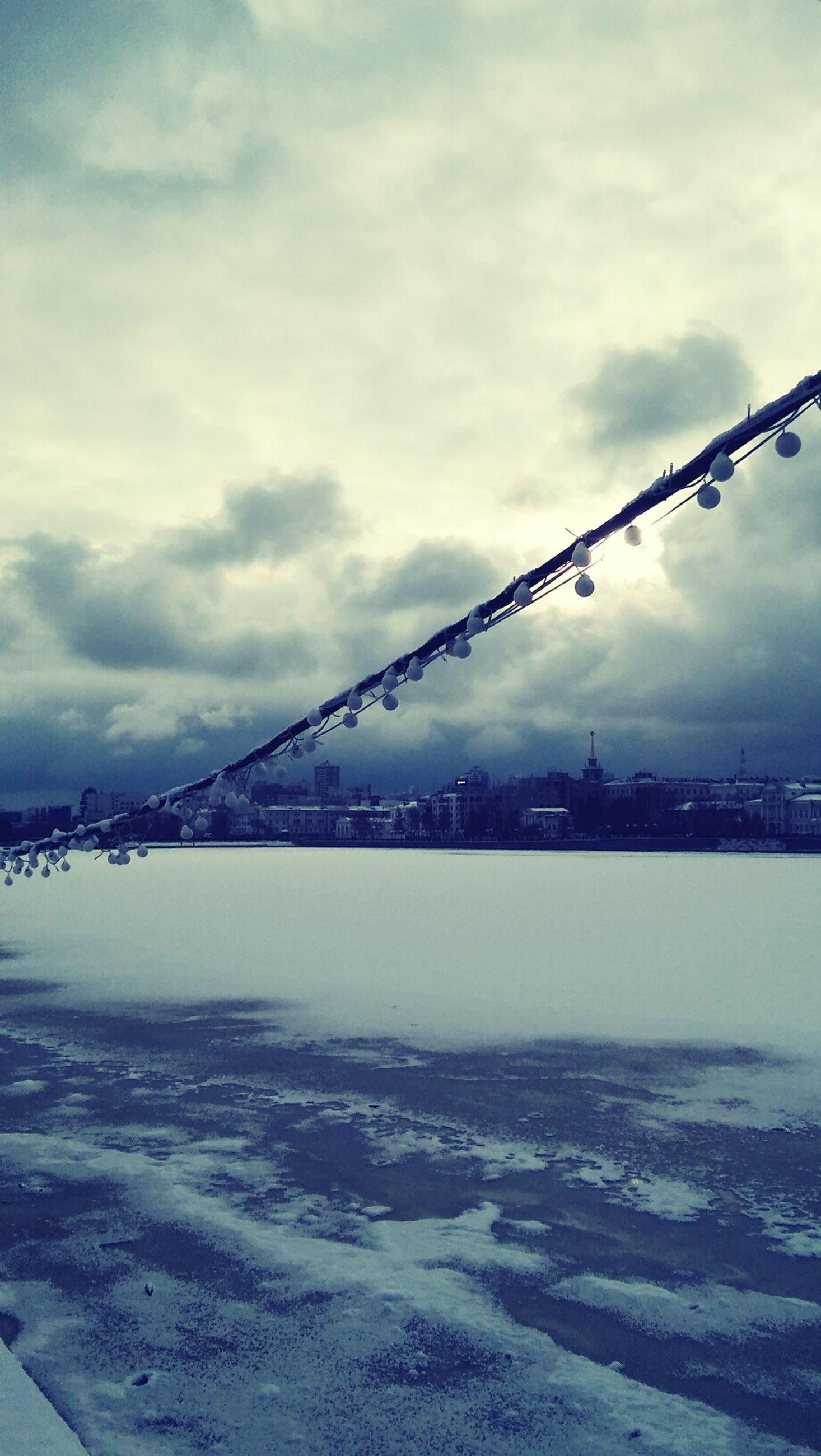 sky, water, connection, built structure, cloud - sky, bridge - man made structure, architecture, sea, suspension bridge, river, engineering, transportation, waterfront, cloudy, nature, cloud, outdoors, weather, city, dusk