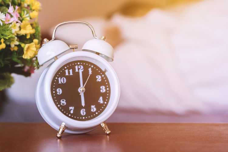 Alarm Clock Time Clock Table Furniture Indoors  Close-up Bed Flower Focus On Foreground No People Flowering Plant Bedroom Number Clock Face Night Table Minute Hand Still Life Plant Single Object Personal Accessory Checking The Time