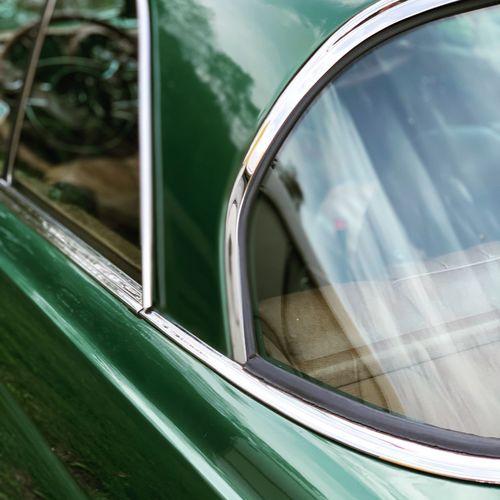 Close-up of green car