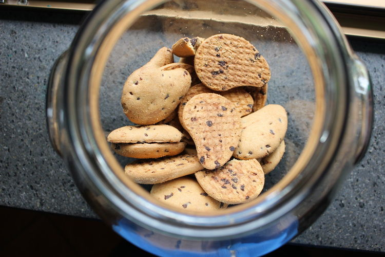 Cookies inside of glass jar on table