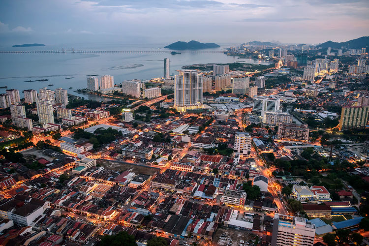 Aerial View Architecture Building Exterior Buildings City Cityscape Coastline Dronephotography Dusk Heritage High Angle View Outdoors Penang Roof Sky Skyscraper Streetlights Sunset Tall Urban Skyline