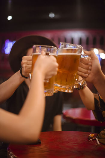 Beer Fun Adult Alcohol Bar - Drink Establishment Beer Beer - Alcohol Beer Glass Celebratory Toast Drink Drinking Drinking Glass Food And Drink Friendship Glass Group Of People Hand Happy Hour Human Body Part Human Hand Leisure Activity Nightlife Real People Refreshment Smiling