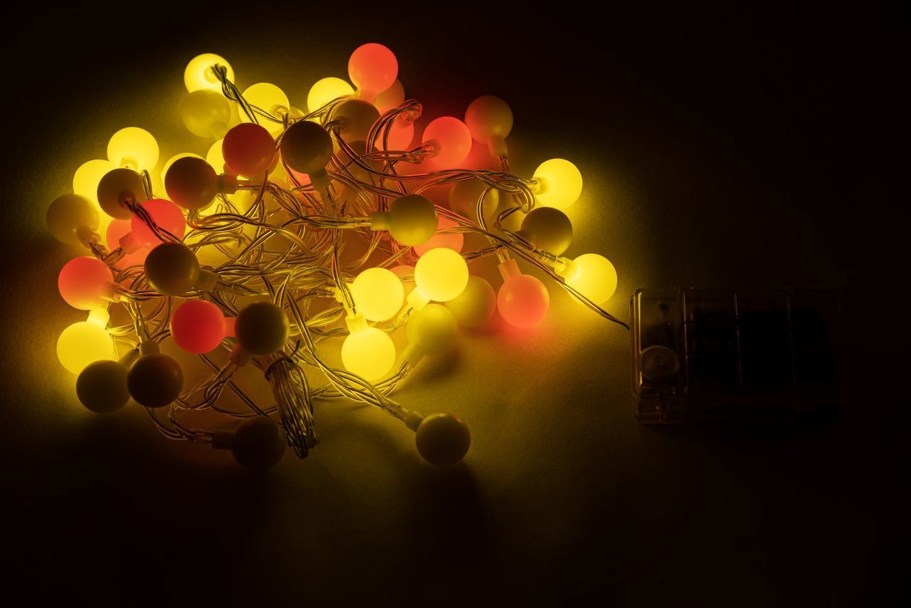 illuminated, lighting equipment, no people, decoration, glowing, indoors, night, light, close-up, light - natural phenomenon, lens flare, electric light, celebration, technology, low angle view, selective focus, circle, electricity, geometric shape, dark
