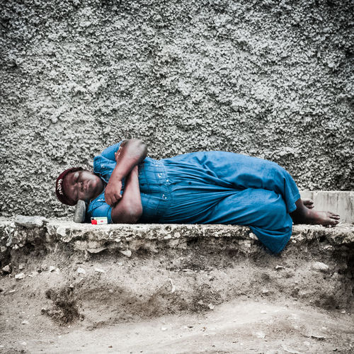 -- Between a rock and a hard place -- For this mentally ill woman in Kingston, Jamaica, trying to find comfort is literally between a rock (pillow) and the hard, hard ground. Hard Place Harsh Reality... Homeless Jamaica Kingston Lying Lying On Ground Mentally Ill Portrait Real People Rock Sleeping Woman