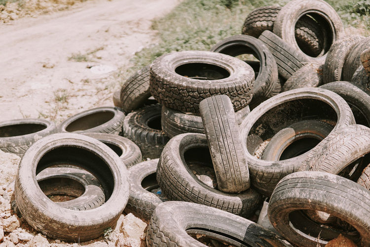 Close-up of abandoned tires at junkyard