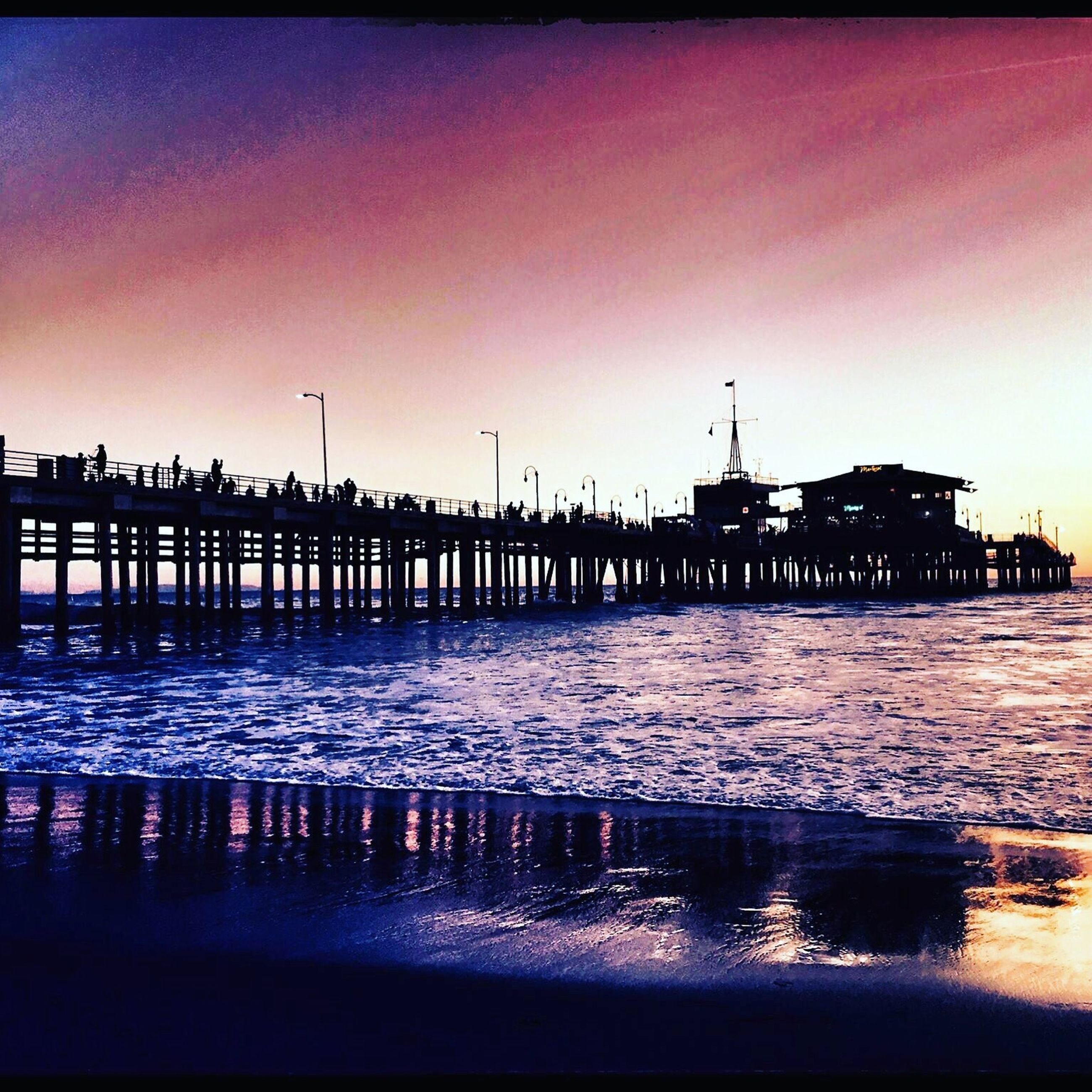 water, sunset, built structure, architecture, silhouette, sea, waterfront, pier, clear sky, building exterior, dusk, sky, transfer print, auto post production filter, reflection, river, copy space, tranquil scene, tranquility, scenics