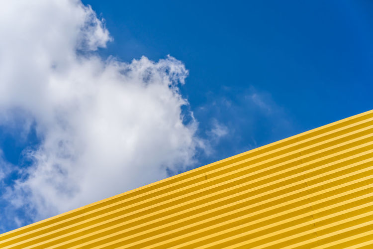 Low angle view of yellow roof against sky