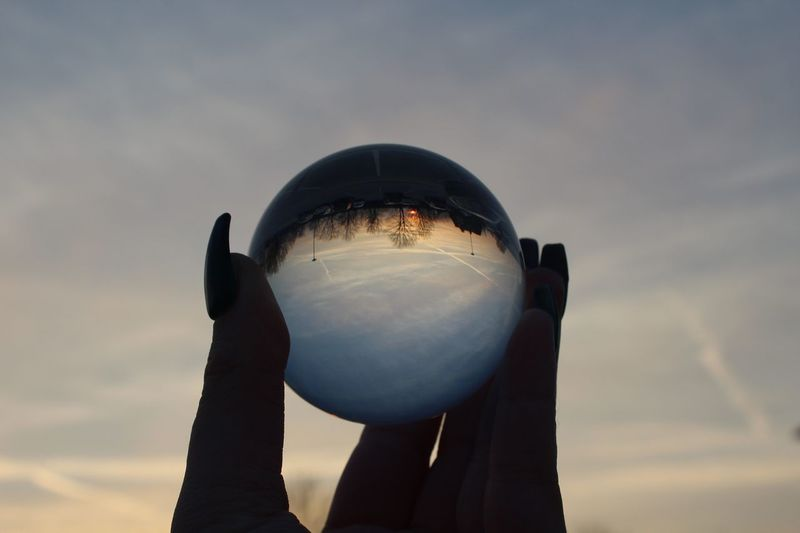 EyeEm Gallery EyeEm Best Shots EyeEmNewHere Canon crystal clear Crystal Sky Holding One Person Nature Cloud - Sky Unrecognizable Person Real People Outdoors Human Hand Leisure Activity Sphere Human Body Part Sunset Lifestyles Hand Low Angle View Crystal Ball Day Personal Perspective Inner Power End Plastic Pollution