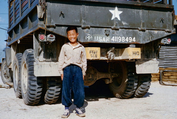 Korea War Air Force Hospital Korean War South Korea Adult Cheerful Confidence  Day Emotion Front View Full Length Happiness Land Vehicle Looking At Camera Mode Of Transportation Occupation One Person Portrait Pride Smiling Standing Transportation Truck Wheel