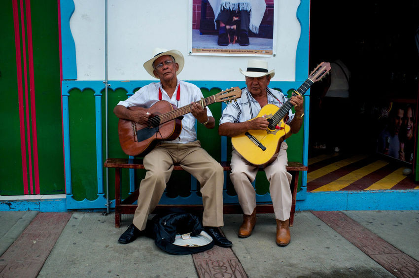 Old musicians playing guitar in the streets of Salento, Colombia Friendship Gray Hair Guitarist Guitarists Music Outdoors People Playing Street Musicians
