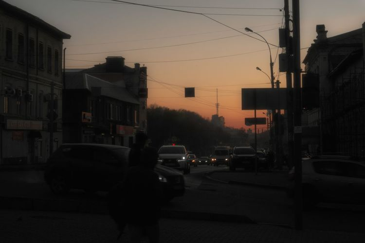 Traffic on street in city at dusk