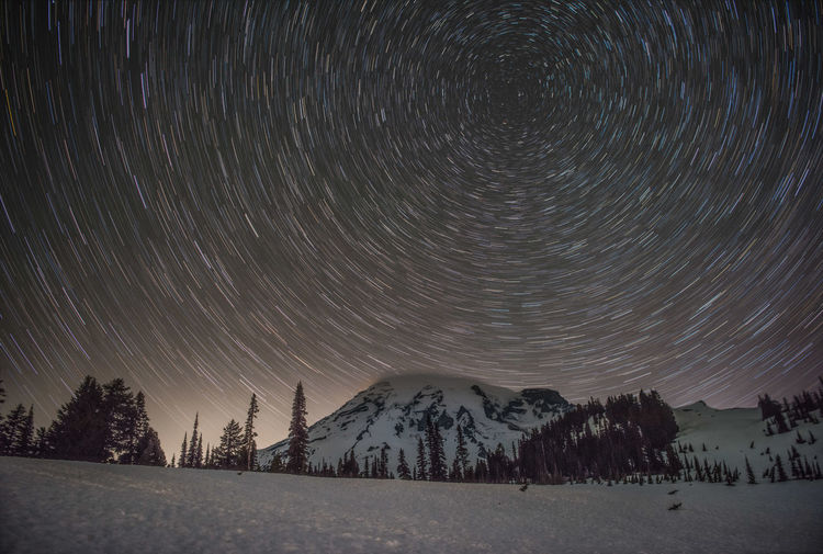 Dancing Stars Astronomy Capture The Moment Enjoying Life Exploring Landscape Long Exposure Low Angle View Mountain Night Night Sky Sky Snow Star - Space Star Field Star Trail The Great Outdoors - 2017 EyeEm Awards Travel Travel Destinations Tree