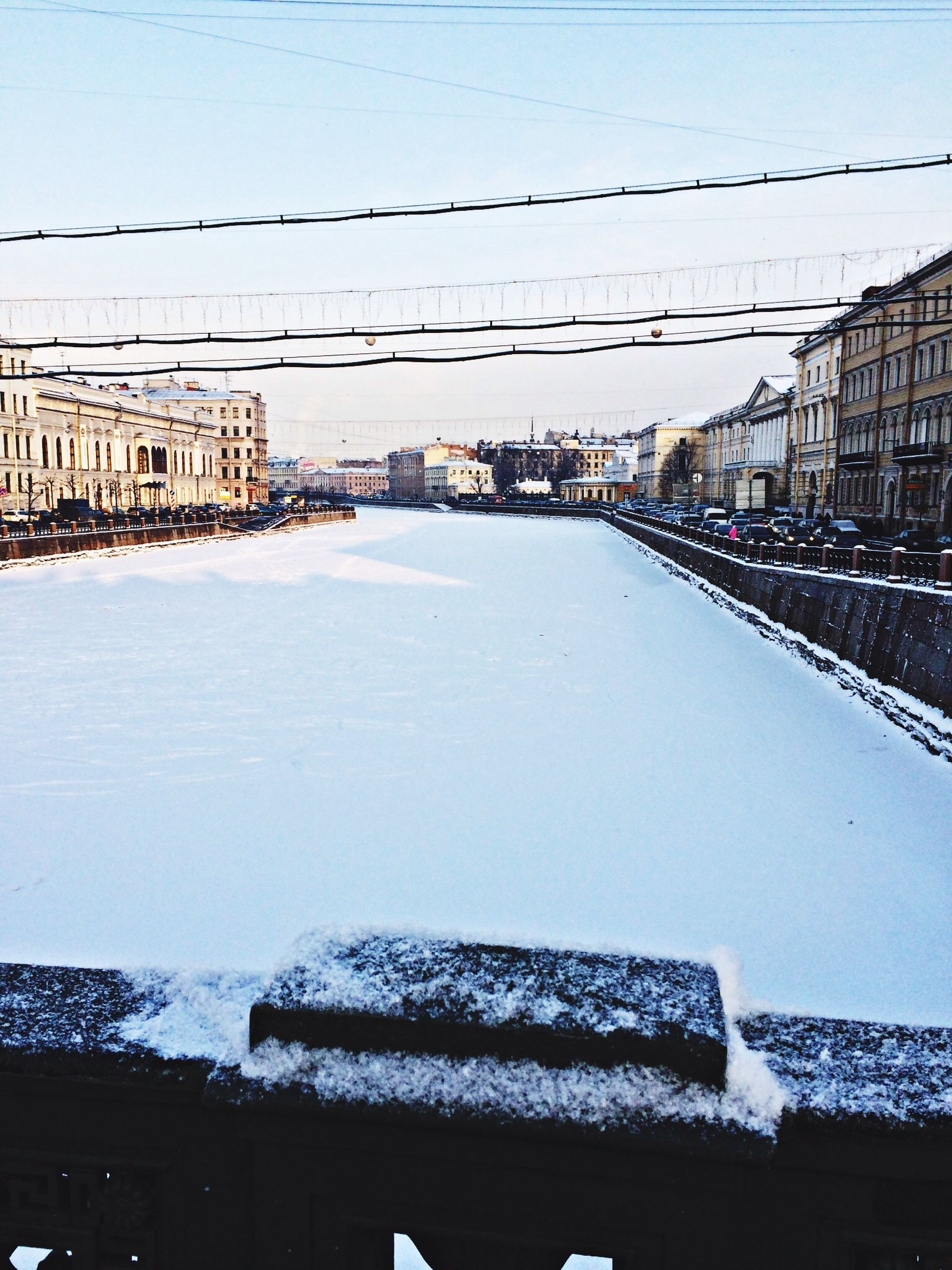 architecture, built structure, building exterior, winter, snow, cold temperature, season, clear sky, water, residential building, residential structure, house, frozen, city, railing, connection, weather, outdoors, sky, day