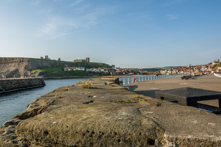 Whitby Whitby Harbour Whitby View Whitby North Yorkshire North Yorkshire North Yorkshire Coast Seaside Seaside Town Tourist Destination Coast Coastline Whitby Pier Sunlight Outdoors Day River Water Sky Town Building Building Exterior Stone Stone Wall Architecture Built Structure