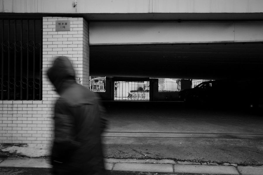 Blurred Motion Motion Architecture Real People Built Structure One Person Transportation Walking Lifestyles Building Exterior Side View on the move City Day Footpath Unrecognizable Person Standing Sidewalk Outdoors Streetphotography Blackandwhite