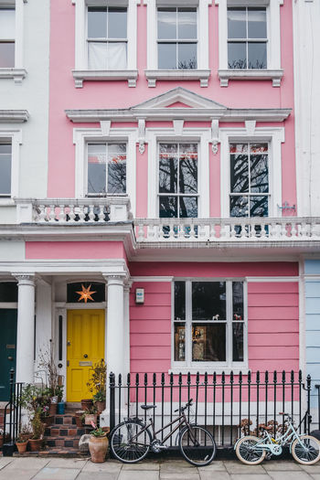 Bicycles by pastel pink coloured terraced house in Primrose Hill, London, UK. London Uk Primrose Hill Sidewalk House Entrance Outdoors City Façade Door No People Building Exterior Pastel Colored Terraced Houses Bicycles Front Door Entrance Exterior Pink Color Luxury Victorian House Day Building Architecture Colourful