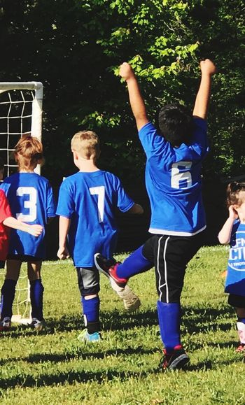 Thrill Of Victory Soccer Player Soccer Soccer Uniform Soccer Field Sport Soccer Ball Boys Full Length Soccer Team  Childhood Outdoors Day Teamwork Togetherness Healthy Lifestyle Sports Clothing Child Sports Team Grass 100 Days Of Summer Rear View