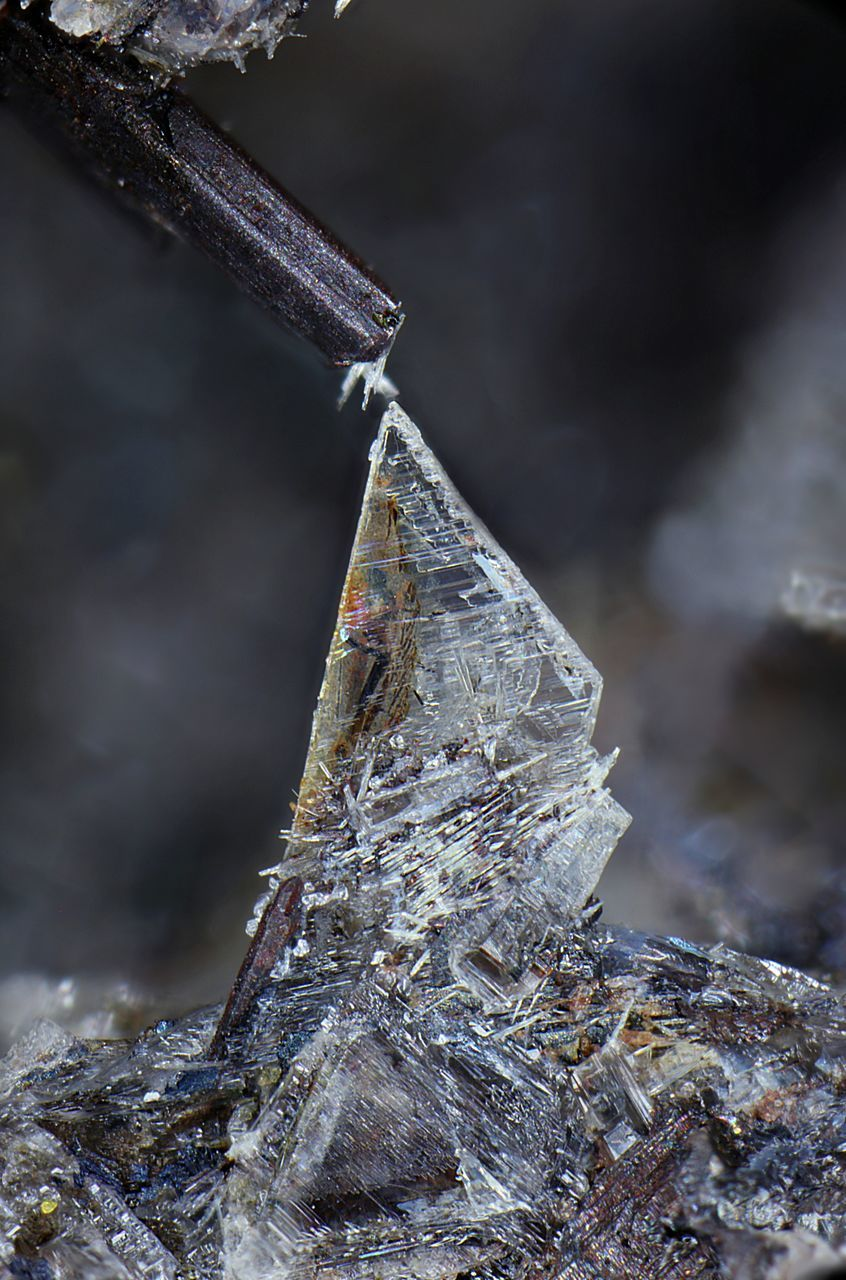 CLOSE-UP OF FROZEN ROCK ON METAL