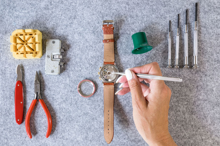 Repairing Adult Art And Craft Body Part Close-up Craft Directly Above Finger Hand High Angle View Holding Human Body Part Human Hand Human Limb Indoors  Mechanical Watch Men Occupation Old Profession One Person Preparation  Real People Repair Skill  Tweezers Watch Watchmaker Work Tool Working