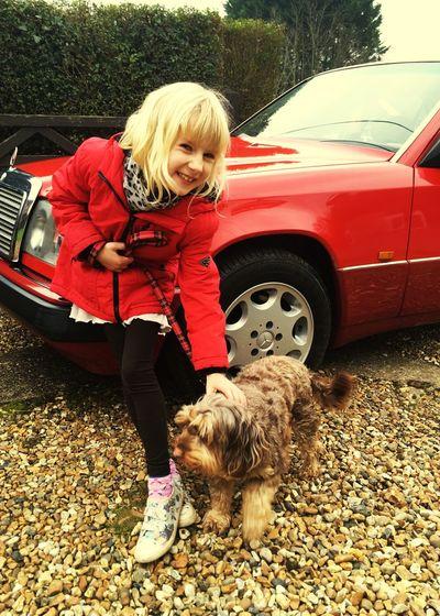 RED! Cute dog & girl. Shiny car