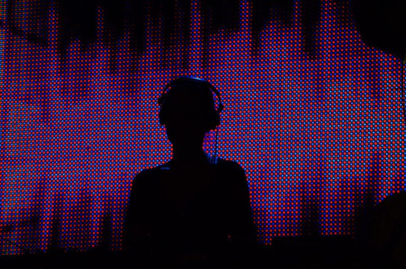 Silhouette Dj Playing Music At Night Club