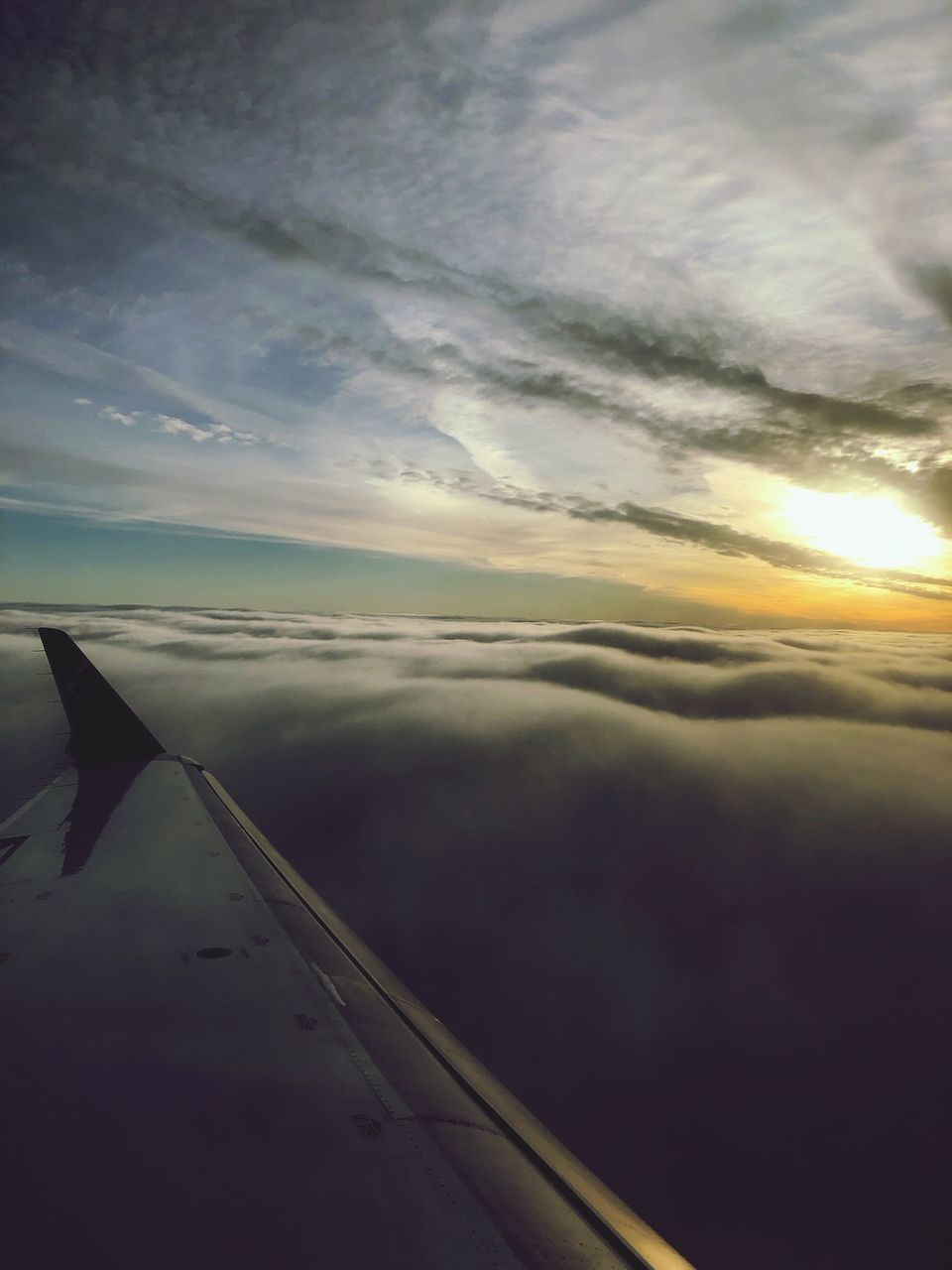 cloud - sky, sky, transportation, air vehicle, sunset, airplane, mode of transportation, beauty in nature, scenics - nature, nature, no people, flying, aircraft wing, travel, mid-air, outdoors, tranquility, motion, tranquil scene, cloudscape