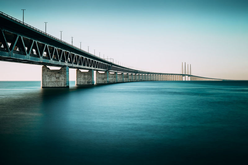The mighty Öresunds bridge between Sweden and Denmark. Denmark EyeEm Best Shots Sweden Tranquility Architecture Bridge Bridge - Man Made Structure Built Structure City Clear Sky Connected Connection Day Engineering Long Exposure Nature No People Outdoors River Sky Transportation Water öresundsbron øresund