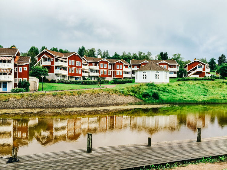 Architecture Building Exterior Built Structure Community Dalarna Day Geometry Horizontal Symmetry House Human Settlement Lake Leading Outdoors Reflection Residential District Residential Structure Roof Scandinavia Standing Water Summer Town Tree Trip Water Waterfront