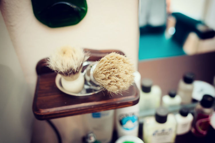 Brush shaving set in barber shop. Technique of selective focus. Barbershop Objects Vintage Filter Vintage Style Accessories Barber Barber Life Brush Brush Shaving Close-up Day Indoors  No People Shaving Shaving Brush Table Tool Vintage