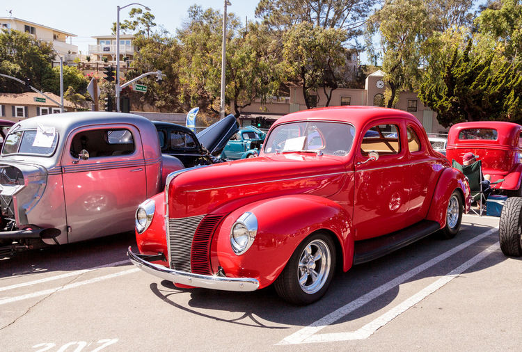 Laguna Beach, CA, USA - October 2, 2016: Red 1940 Ford Deluxe Opera Coupe owned by Susan Reese and displayed at the Rotary Club of Laguna Beach 2016 Classic Car Show. Editorial use. 1940 Car Car Show City Classic Car Classic Car Show Day Ford Ford Deluxe Ford Deluxe Opera Coupe Laguna Beach No People Old Car Old-fashioned Opera Coupe Outdoors Red Vintage Car