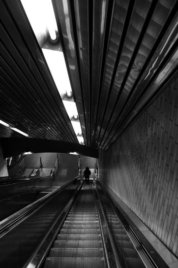 Subterranean. Reflection Illuminated Going Way Down Photography Black And White Escalator Indoors  Transportation Connection Adult One Person