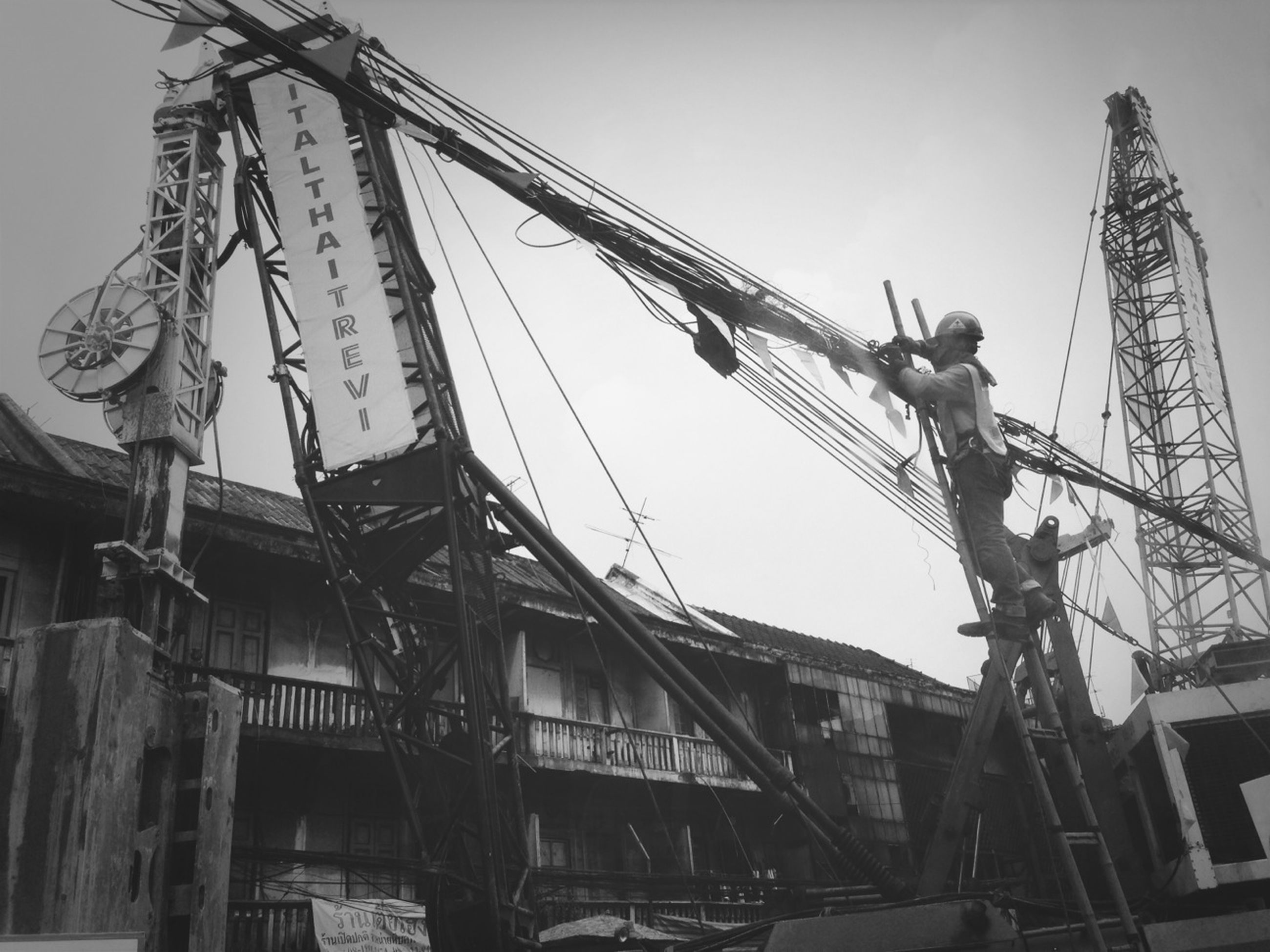 low angle view, built structure, architecture, building exterior, clear sky, construction site, sky, construction, day, crane - construction machinery, development, outdoors, construction industry, building, no people, metal, incomplete, city, industry, residential building