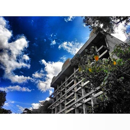 Abandoned building.. Abandoned Building Busay Clouds sky bluesky Cebu pinasshoutout Pinoy love life potd architecture TagsForLikes city urban design minimal town street art architecturelovers abstract lines lookingup style composition perspective geometric pattern
