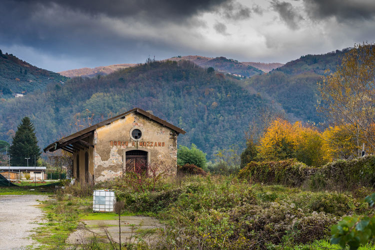 Abandoned railway station at Borgo a Mozzno in Tuscany. Autumn Station Abandoned Architecture Beauty In Nature Building Exterior Built Structure Cloud - Sky Day Grass Landscape Mountain Nature No People Outdoors Railway Railway Station Scenics Sky Tranquility Tree Water
