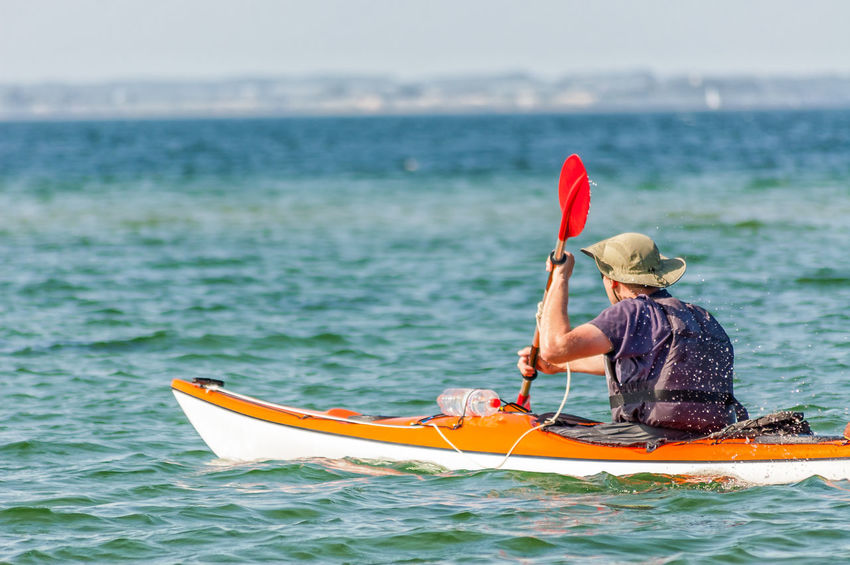 kayaking at the Baltic Sea Baltic Sea Focus On Foreground Kayak Kayaker Kayaking Kayaking In Nature Leisure Activity Nature Nautical Vessel Oar Rear View Sea Water Waterfront