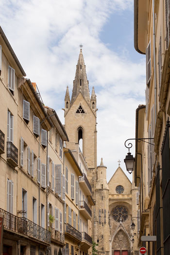 High section view of Church of San Juan de Malta, Aix-en-Provence Ancient Architecture Building Exterior Built Structure Cathedral Church City City Life Cloud - Sky Day Low Angle View Medieval No People Old Town Outdoors Place Of Worship Religion Sky Spire  Spirituality Town Window