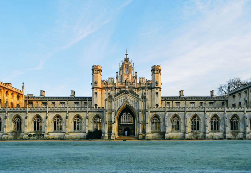 St John's College Cambridge Arcade Arch Arched Architectural Column Architecture Blue Building Exterior Built Structure Cambridge Cambridgeshire Church Culture Day Façade Famous Place History In Front Of Lawn No People Outdoors Place Of Worship Religion Sky Tourism Vapor Trail