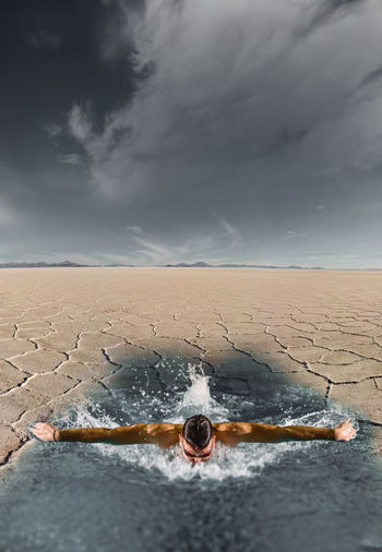 Swimming in the desert Cloud - Sky Sky Nature Land Storm Day No People Environment Storm Cloud Outdoors Sand Horizon Over Land Overcast Scenics - Nature Horizon Dramatic Sky Landscape Remote Wet Ominous Climate Sport Swiming