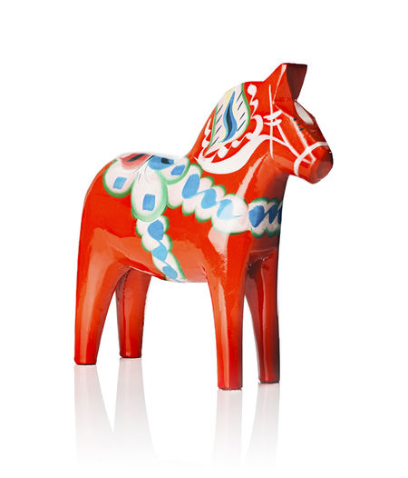 A Traditional Dalecarlian horse or Dala horse (Swedish: Dalahast) It has become a symbol of Dalarna as well as Sweden in general. The design of the horse has been around for centuries. Dal Dalahadapower Dalahäst Dalecarlia Decoration Horse Isola Isolated Object Obsolete Scandinavian Souvenir Statue Sweden Swedish Tradition White Background