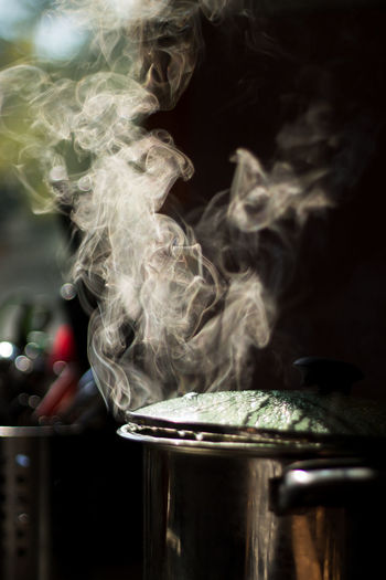 Close-Up Of Steam Emitting From Cooking Utensil
